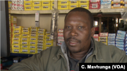 Spare vehicle parts seller Tongai Madamombe says he wants President Emmerson Mnangagwa's government to switch to the U.S. dollar, as pricing in Zimbabwe's local currency bond-notes has become difficult for importers, in Harare, May 31, 2019.