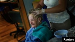 An Alzheimer's patient has her hair done in Mexico City in 2012
