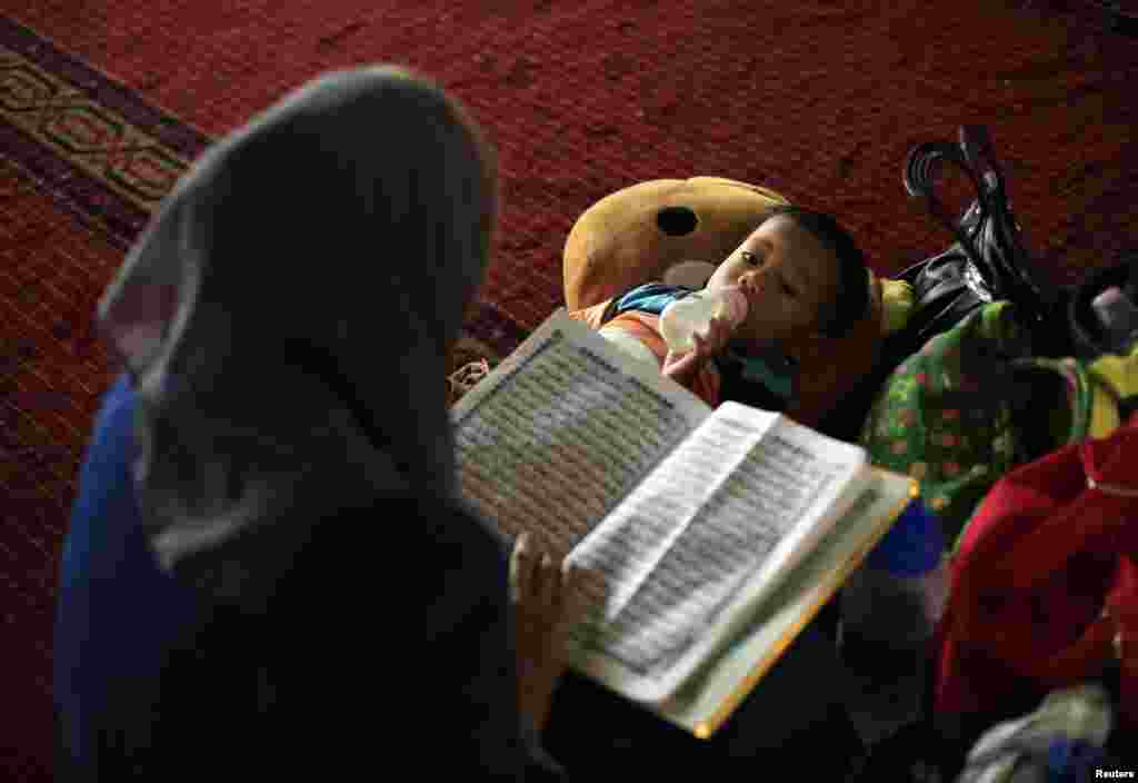 A mother and child after mass Friday prayers inside Istiqlal Mosque in Jakarta, July 4, 2014.