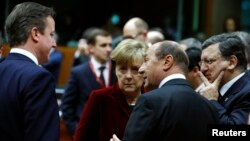 Britain's Prime Minister David Cameron (L-R), Germany's Chancellor Angela Merkel, Romania's President Traian Basescu and European Commission President Jose Manuel Barroso attend a European leaders emergency summit on Ukraine, March 6, 2013.