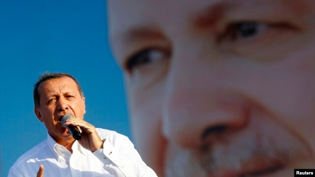 Turkey's Prime Minister and presidential candidate Tayyip Erdogan addresses his supporters during an election rally in Istanbul, August 3, 2014.