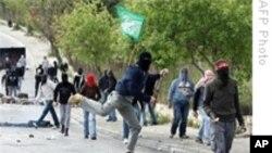 پـۆلیسی ئیسرائیلی و فهڵهسـتینیـیهکان له ڕۆژههڵاتی ئۆرشهلیم بهیهکدا دهدهن