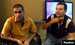 Mohammed Abd Ahmed, right, and Ahmed Mahmoud Mustafa, two of the 69 hostages rescued from an Islamic State prison in a joint raid by U.S. and Kurdish special forces, attend an interview with Reuters in Irbil, Iraq, Oct. 29, 2015.
