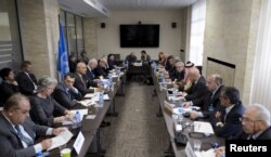 FILE - A photo shows a meeting between U.N. Syria envoy Staffan de Mistura and members of Syrian opposition at the United Nations office in Geneva, Switzerland, Apr. 22, 2016. Activists believe that the release of detainees in Syria could restart the peace process.