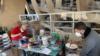Workers designing ceramics plates at Solimene factory in Vietri sul Mare. (Sabina Castelfranco/VOA)
