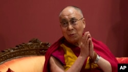 FILE - Exile Tibetan spiritual leader the Dalai Lama listens a to speaker at an event organized by his well-wishers in New Delhi, India, Monday, Jan. 4, 2016.