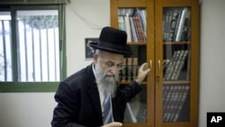 Israeli rabbi Mordechai Nagari, one of the signatories of the controversial ruling, poses for a photo in his office in the Jewish West Bank settlement of Maaleh Adumim near Jerusalem, 07 Dec 2010