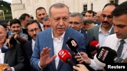 Turkish President Tayyip Erdogan talks to media after the Eid al-Fitr prayers to mark the end of the holy month of Ramadan in Istanbul, Turkey, June 4, 2019. Edogan's government has placed new rules on internet broadcasters.
