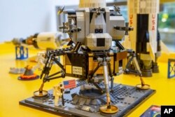 A Lego model of the Apollo 11 lunar lander is displayed in the company's store in New York on Tuesday, June 18, 2019.