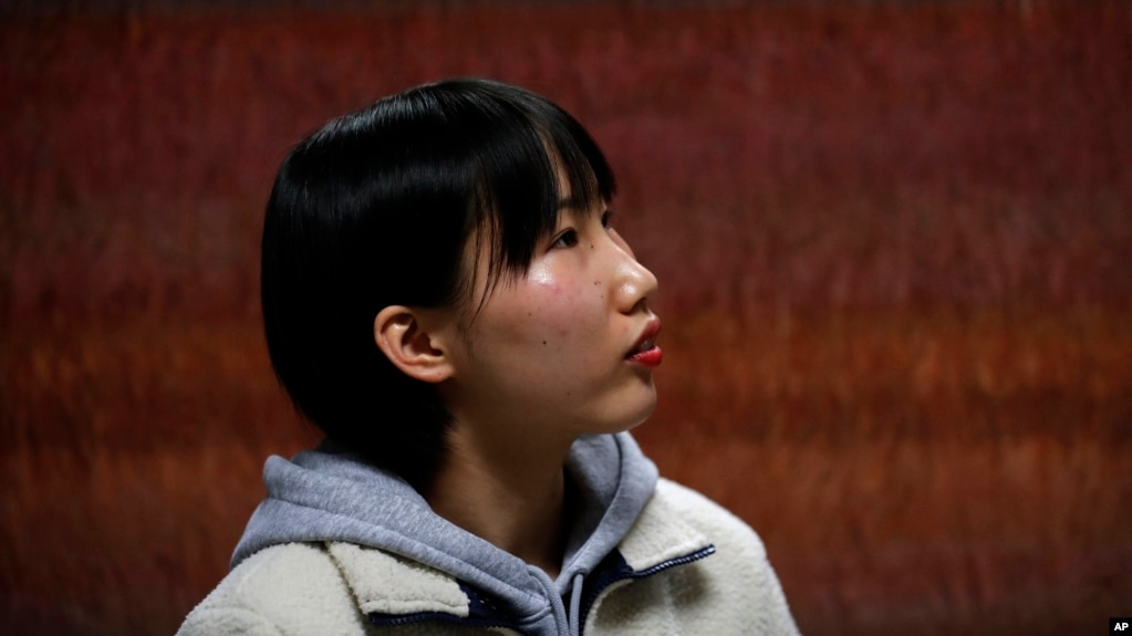 In this Nov. 6, 2019, photo, Song Hong Ryon, pauses for a moment during an interview in Uijeongbu, South Korea. Song Hong Ryon looks like any other young woman in South Korea. But three years after her arrival from China, the half-North Korean, half-Chine