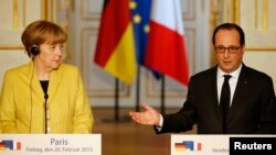 FILE - Documents cited by WikiLeaks reportedly include summaries of French officials' conversations on, among other things, the relationship between the administrations of German Chancellor Angela Merkel and French President Francois Hollande.