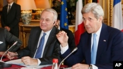 French Foreign Minister Jean Marc Ayrault, left, and U.S. Secretary of State John Kerry attend a meeting at the Quai d'Orsay ministry in Paris, March 13, 2016. Kerry and his counterparts were to discuss Syria, Libya, Yemen and Ukraine, among other foreign