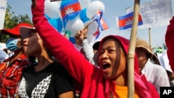 Cambodian garment workers shout slogans during a gathering to mark May Day celebrations in Phnom Penh, Cambodia, file photo.