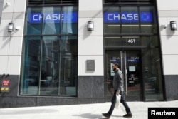Cameras are seen on the exterior of a Chase Bank branch in New York City U.S., April 7, 2021. REUTERS/Brendan McDermid/File Photo