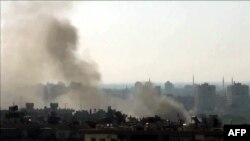 An image grab taken from a video uploaded on YouTube on July 22, 2012 shows smoke billowing from the al-Mazzeh neighborhood of Damascus, Syria.