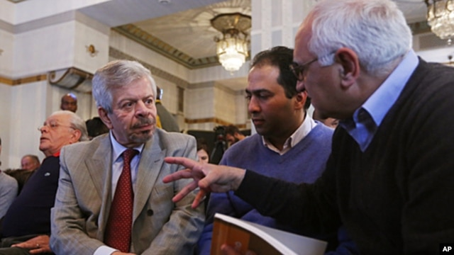 Nofal Al Dawalibi (l), son of former Syrian PM, speaks to journalists before a news conference to unveil a plan to form Syrian interim government in Paris, France, April 26, 2012.