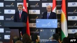 Turkish Energy Minister Taner Yildiz (L) and his Iraqi Kurdish counterpart Ashti Hawrami hold a press conference in Arbil, the capital of the autonomous Kurdish region in northern Iraq, Dec. 2, 2013.