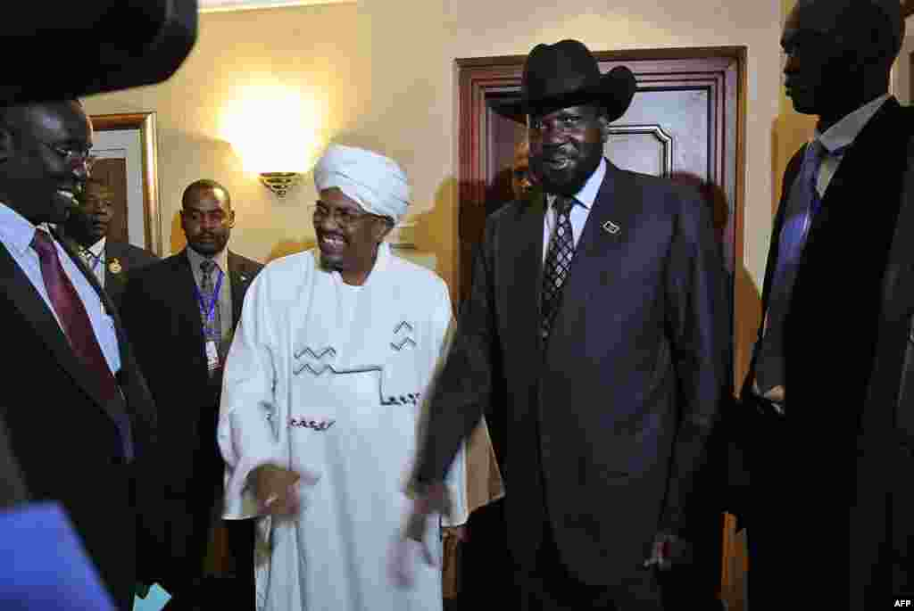I advise the African Union to ensure South Sudan and Sudan implement the cooperation agreements. The AU should deal with whomever obstructs the implementation of the agreements, regardless of whether they are from Sudan or South Sudan. - Angelo Akec Dengdit in Western Bahr al Ghazal state Sudanese President Omar al-Bashir (Center L) smiles after shaking hands with his South Sudanese counterpart Salva Kiir (Center R) following a meeting in the Ethiopian capital Addis Ababa, July 14, 2012. The agreements lay moribund until earlier this month, when a timeline for implementing them was agreed to.