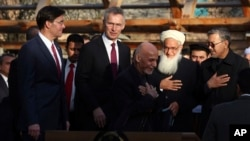 Afghan President Ashraf Ghani, center, arrives with NATO Secretary General Jens Stoltenberg, and U.S. Secretary of Defense Mark Esper for a joint news conference in presidential palace in Kabul, Afghanistan, Feb. 29, 2020.