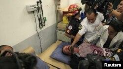 約翰.邁卡菲星期四在危地馬拉的一家醫院接受治療
