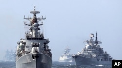 "In this May 24, 2014 photo, China's Harbin (112) guided missile destroyer, left, and the DDG-139 Ningbo Sovremenny class Type-956EM destroyer, right, take part in a China-Russia ""Joint Sea-2014"" navy exercise at the East China Sea off Shanghai, China."