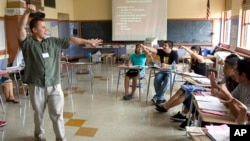 FILE — Teacher Xavier Chavez, standing, teaches a summer history class at Benson High School in Portland, Oregon.
