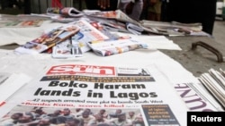 Newspapers are displayed at a vendor's stand along a road in Obalende district in Nigeria's commercial capital Lagos, July 30, 2013.