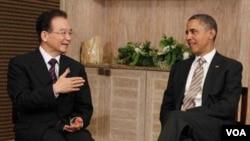 El presidente Barack Obama durante su reunión con el primer ministro Wen Jiabao durante su encuentro en la cumbre de ASEAN.