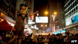 A pro-democracy protester talks on a loudspeaker to there gathered in the Mong Kok district of Hong Kong, Oct. 5, 2014.
