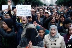 Anti-government protesters shout during a rally organized by the 20th February, the Moroccan Arab Spring movement in Casablanca, Morocco, Sunday, Nov 20, 2011, in a mass popular call to bring more democracy into this North African kingdom.