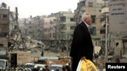 دمشق کے ایک مضافاتی علاقے میں تباہی کا منظر