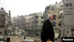 Oštećene zgrade u blizini Damaska