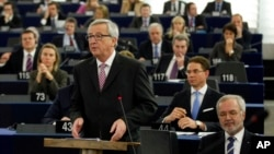 European Commission President Jean-Claude Juncker delivers his statement on growth, jobs and investment package for Europe, at the European Parliament in Strasbourg, France, Nov. 26, 2014.