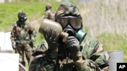 FILE - A U.S. Army soldier drinks water during a CBR (chemical, biological and radiological) warfare training exercise at Yeoncheon near the border with North Korea, in South Korea, May 16, 2013.