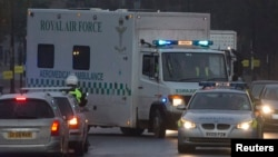 A convoy carrying a female Ebola patient arrives at the Royal Free Hospital in London Dec. 30, 2014.