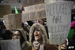 Demonstrators protest President Donald Trump's executive order which imposes a freeze on admitting refugees into the United States and a ban on travel from seven Muslim-majority countries at the international terminal at O'Hare Airport, Jan. 29, 2017 in Chicago, Illinois.