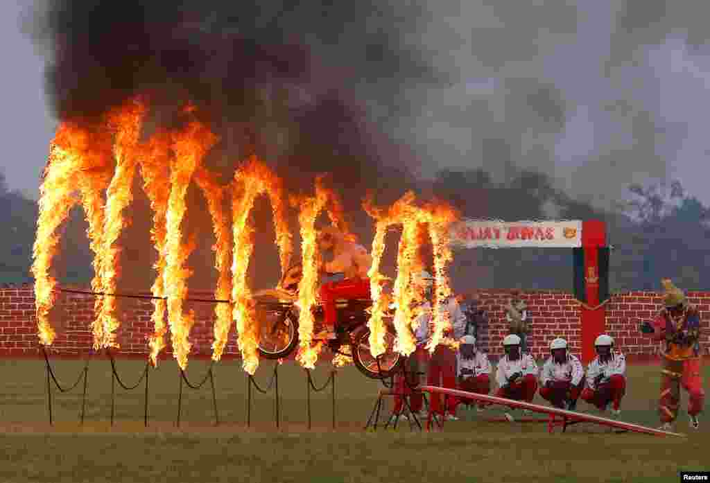 An Indian army soldier performs a stunt during celebrations ahead of the 'Vijay Diwas,' a ceremony to celebrate the Dec. 16, 1971 liberation of Bangladesh by the Indian Armed Forces, in Kolkata, India.