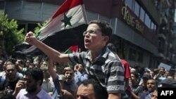 Mısır'daki Suriyeliler Beşar Esat karşıtı gösteri yapıyor