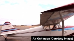 Oshinuga in his vintage Cessna airplane