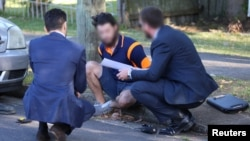Australian police question one of two men arrested on charges related to fighting with Syrian militants in a raid in the Sydney suburb of Birrong, Australia, Nov. 3, 2016.