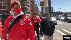Chris Carbonell (left), a team lead of the Guardian Angels squad in Queens. (Photo by Janine Phakdeetham)