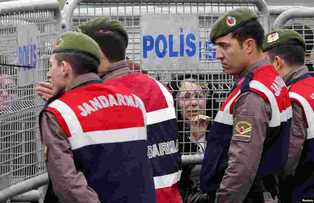 Gendarmes stand guard as visitors wait behind security barriers outside the courthouse in Silivri near Istanbul. The trial of nearly 300 people, who are charged with attempting to overthrow Turkish Prime Minister Tayyip Erdogan's Islamist-rooted government, resumed at Silivri prison complex.