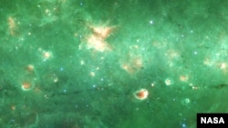 Researchers have identified a new spine-like structure of our Milky Way galaxy - a long, dense tendril of dust and gas. Credit: NASA/JPL/SSC