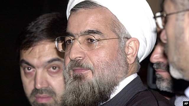 FILE - Hassan Rohani, center, during a meeting at the European Council building in Brussels, Nov. 17, 2003.