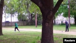 FILE - North Charleston police officer Michael Slager (R) is seen allegedly shooting 50-year-old Walter Scott in the back as he runs away, in this still image from video in North Charleston, South Carolina taken April 4, 2015.