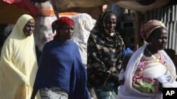 Niger women walk on a street in Niamey, Niger.