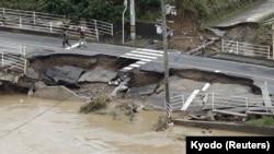 A broken road after heavy rain in Kurashiki, Okayama Prefecture, Japan, July 8, 2018.