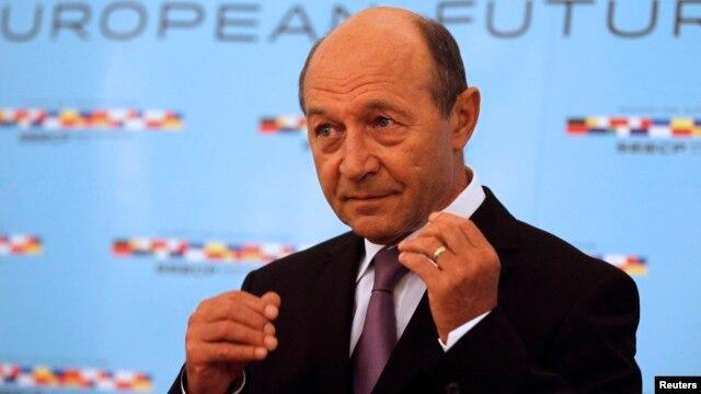 FILE - Romania's President Traian Basescu in Bucharest, June 25, 2014.