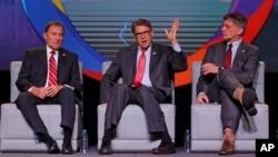 U.S. Energy Secretary Rick Perry, center, speaks as Utah Gov. Gary Herbert, left, and and Wyoming Gov. Mark Gordon look on at an energy summit, May 30, 2019, in Salt Lake City.