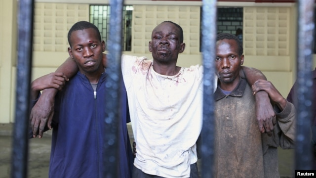 Omar Mwamnuadzi (C), leader of the separatist Mombasa Republican Council shown at a Kenyan prison with members of the group, October 15, 2012.